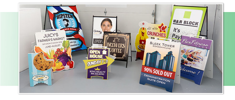 Photo of custom shape cut sandwich signs and more.